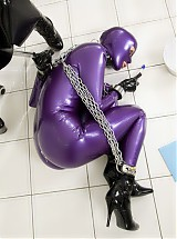 Purple shiny latex girl was bond with chains and forced to clean all joints in the clinic room with toothbrush