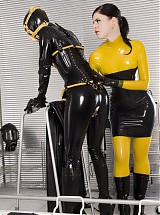 Completely in black shiny latex with rubber cunt on face and pussy