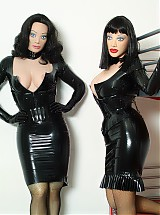 Rubberdolls posing dressed in shiny black latex