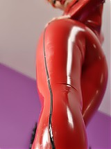 Ulorin Vex in red latex catsuit